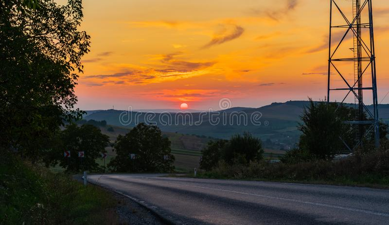 Summer sunset over an empty road royalty free stock photo