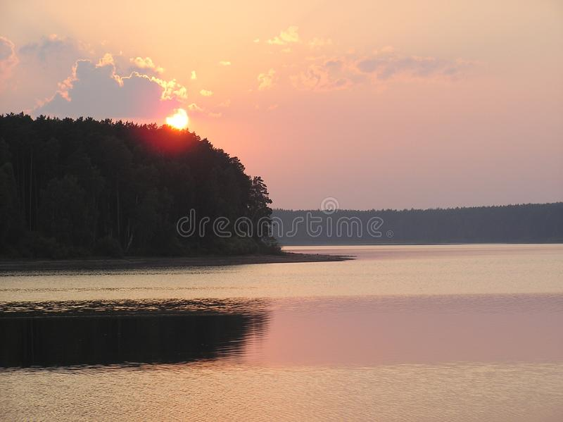 Summer. Sunset over the lake. royalty free stock image