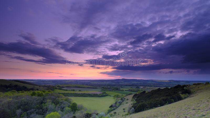 Summer sunset over Meon Valley towards Beacon Hill and Old Winchester Hill, South Downs National Park stock images
