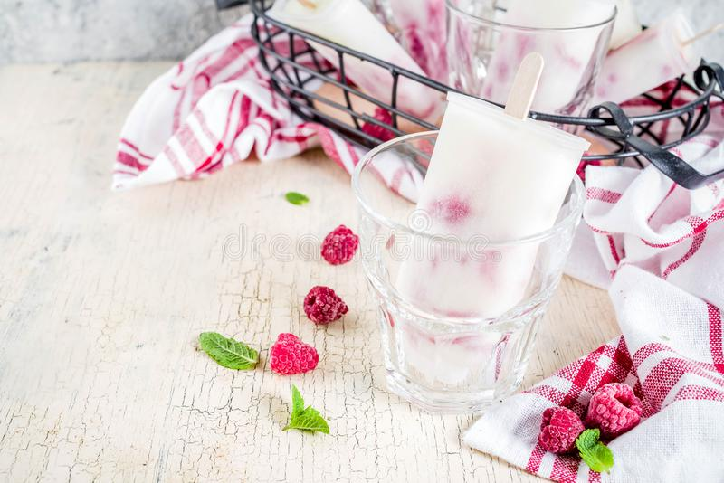 Summer sweet desserts, homemade organic ice cream popsicles from royalty free stock photography