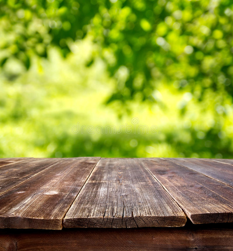 Summer table. Empty table against defocused summer background royalty free stock images