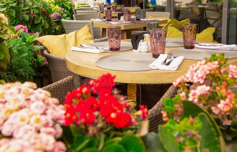 Summer terrace cafe, restaurant. Tables chairs neatly arranged and arranged to serve guests. Summer terrace cafe, restaurant. Tables chairs neatly arranged and stock photo