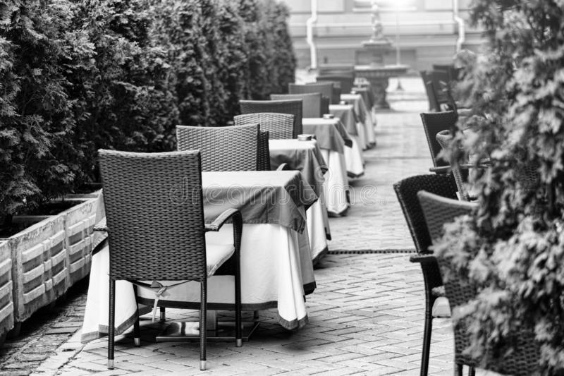 Summer terrace,Empty outdoor area, restaurant, cafe tourist cit. Black and white photo. Summer terrace of a restaurant. Empty outdoor area of restaurant or cafe stock photos