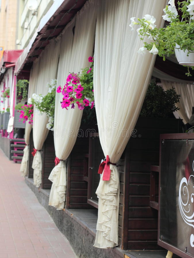Summer terrace. Flowerpots in a row on a summer terrace of a cafe royalty free stock photos