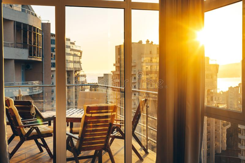 Summer Terrace With Garden Furniture In The Background Of The City And Sunset. Luxuary Apatraments Resort Recreation Summer Concep. Summer Terrace With Garden stock photo