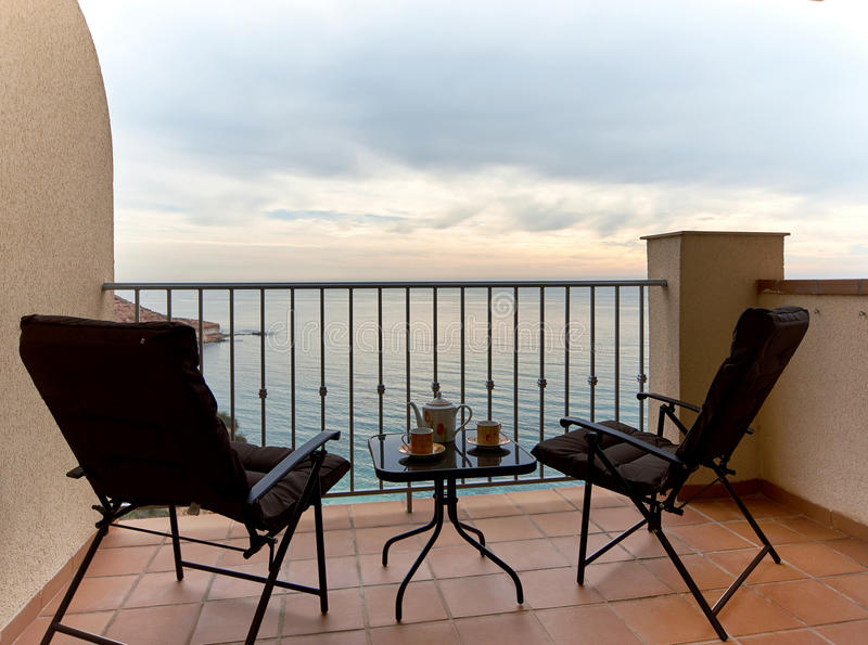 Chairs And Table On A Summer Terrace And View To The Mediterranean Sea.  Spain