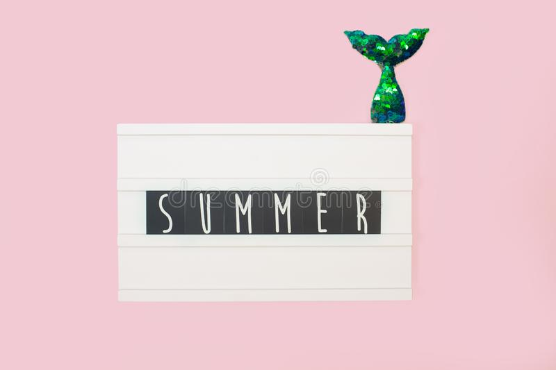 Summer - text on a display lightbox on pink bright background. stock photos