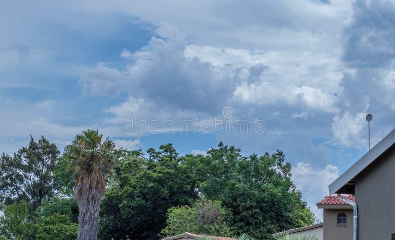 Summer thunder storm buildup Gauteng South Africa. Summer thunder storm clouds build up over a residential neighbourhood in Gauteng Highveld in South Africa stock photography