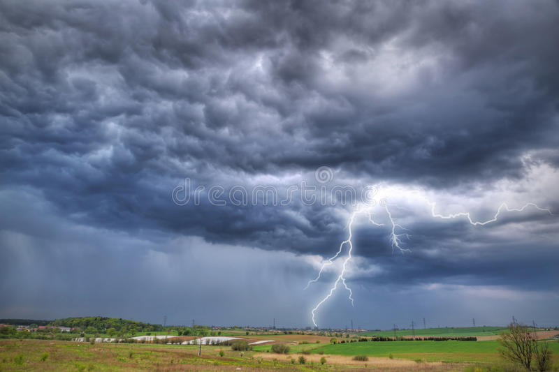 Summer thunderstorm over the meadow. In Poland royalty free stock photo