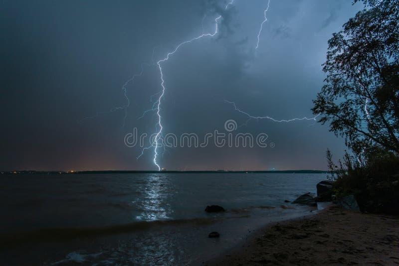 Summer thunderstorm over the Volga. The shine of lightning illuminates the night sky over Kineshma. stock images