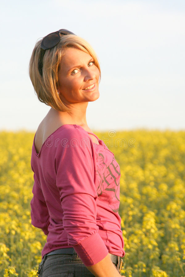 Summer time - Beautiful Day. A beautiful young woman and yellow flowers stock photos