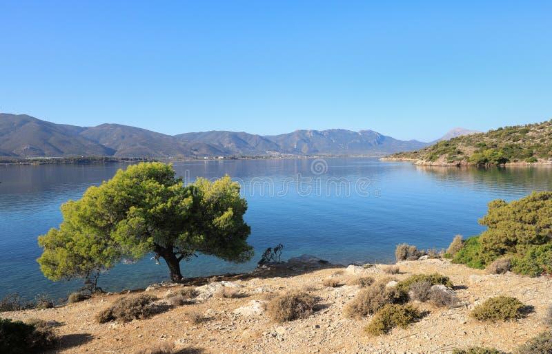 Summer time beautiful seascape of Love bay Poros island, Agrosaronikos, Greece. royalty free stock image