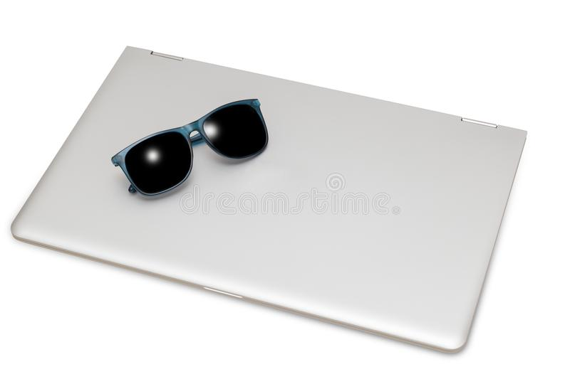 Summer time concept - laptop and sunglasses. On white royalty free stock images