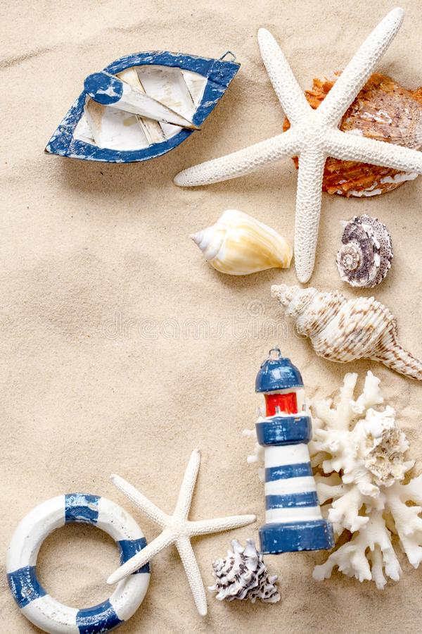 Summer time concept with sea shells and starfish on sand.  royalty free stock image