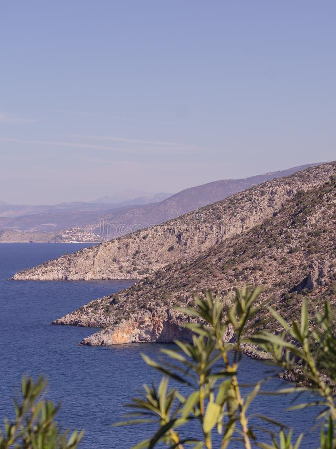 Summer time in Greece. Beautiful Greek coastline next to sea shore during warm weather stock photos