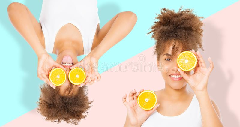 Summer time holidays. Beautiful young african american women with orange fruit food collage isolated . Afro girl and diet concept stock photography