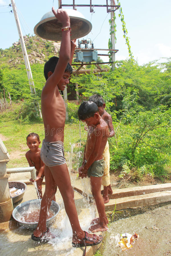 Summer time India. Summer in India is always more then 100 F may be more then that. This photo was taken at some village where boys are trying to cool down with royalty free stock images