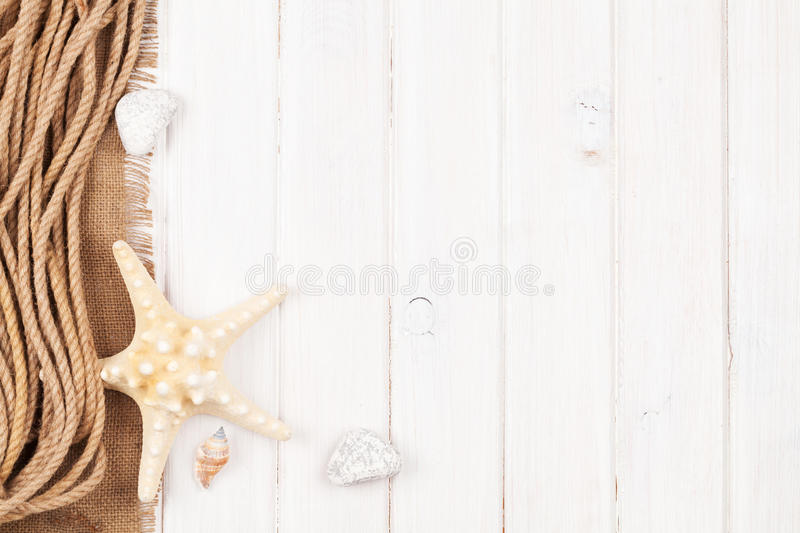 Summer time sea vacation background. With star fish, marine rope and copy space stock photos