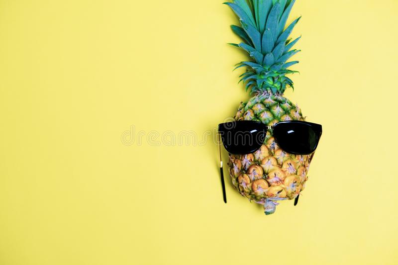 Summer Time To Relax with Funny Pineapple Fruit and Sun Glasses on Pastel Background. Vintage Design Style for Invitation Card stock photo