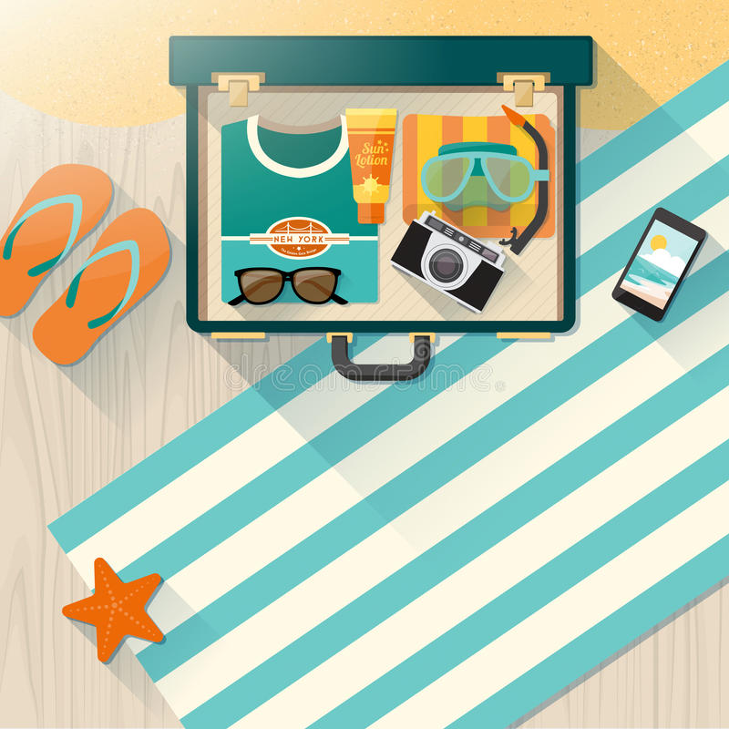 Summer time vacations on the beach. Summer holidays on the beach concept, open vintage suitcase with towel, scuba mask, camera, sunglasses and t-shirt on wooden