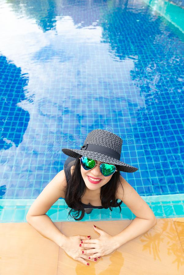 Summer time and Vacations. Women lifestyle relaxing and happy in luxury swimming pool sunbath, summer day royalty free stock photo