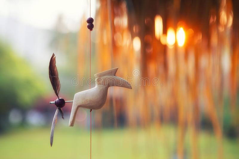 Summer toy bird decoration hand made in the sunset royalty free stock photos