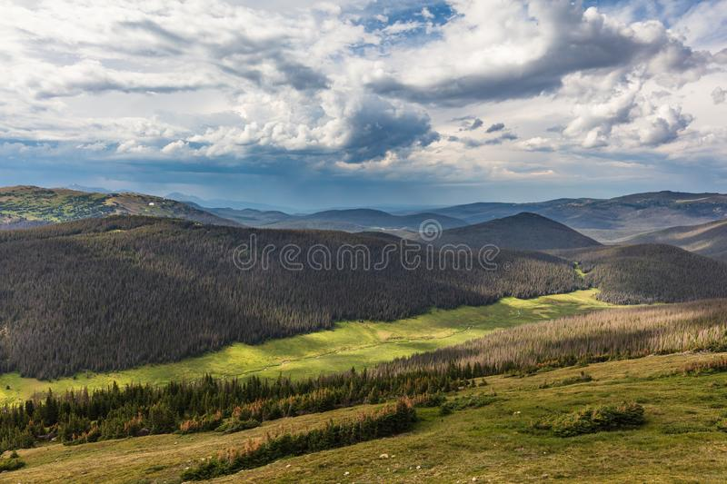 Summer on Trail Ridge, Trail Ridge Road, Rocky Mountain National Park, Colorado, USA. Summer clouds and sun play across the far landscape as seen from the royalty free stock photo