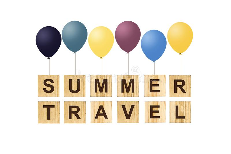 Summer Travel. Concept with words on wooden cubes and inflatable balls. White background. royalty free illustration