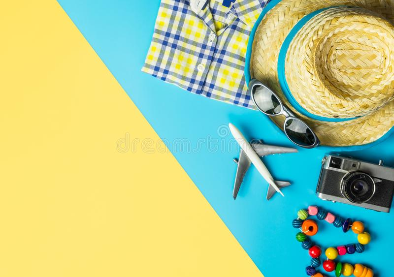Travel fashion and accessories travel top view flatlay on blue yellow. Summer travel fashion and accessories travel top view flatlay on blue yellow stock images