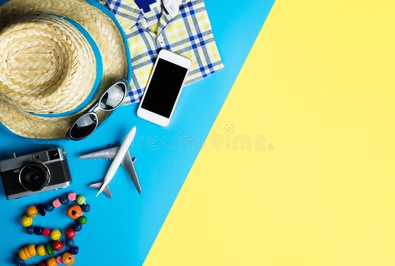 Summer travel fashion accessories travel top view flatlay on blue yellow pink. Summer travel fashion and accessories travel top view flatlay on blue yellow pink stock photography