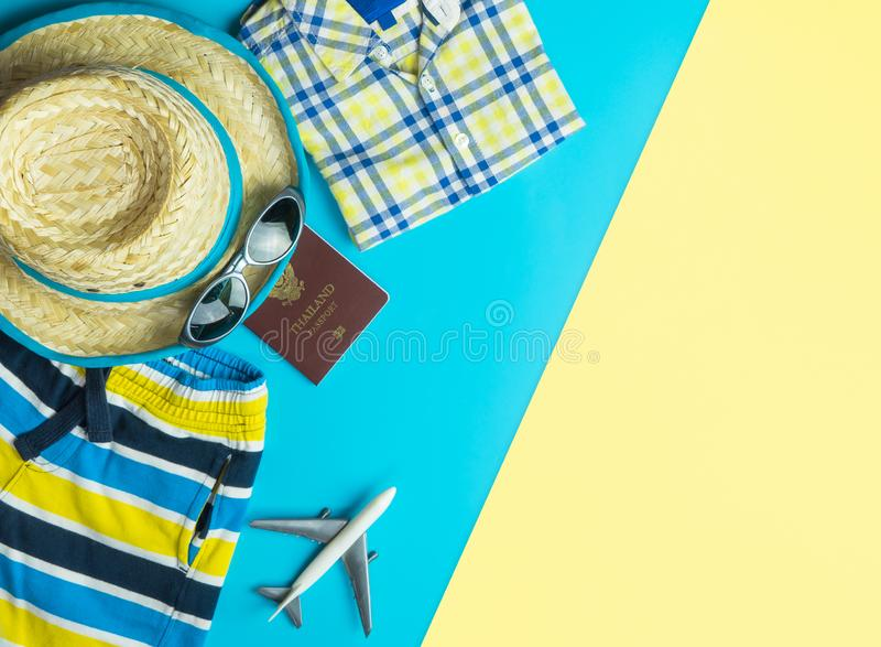 Summer fashion and accessories travel top view flatlay on blue yellow pink. Summer travel fashion and accessories travel top view flatlay on blue yellow pink stock image