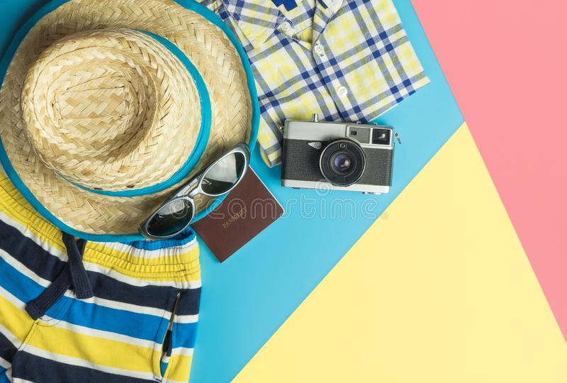 Summer travel fashion accessories travel top view flatlay on blue yellow pink. Summer travel fashion and accessories travel top view flatlay on blue yellow pink stock photos
