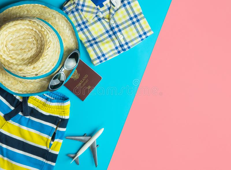 Summer travel fashion accessories travel top view flatlay on blue yellow pink. Summer travel fashion and accessories travel top view flatlay on blue yellow pink stock photo
