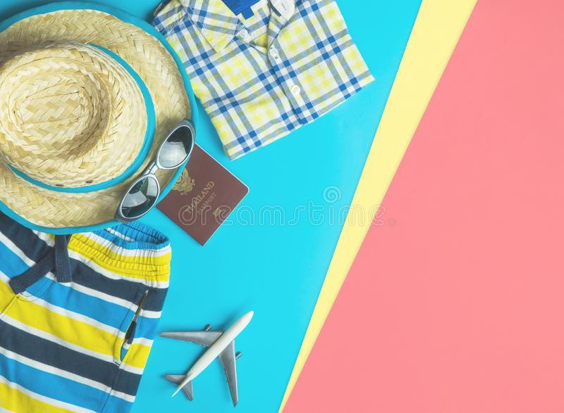 Summer travel fashion accessories travel top view flatlay on blue pink. Summer travel fashion and accessories travel top view flatlay on blue pink stock photo
