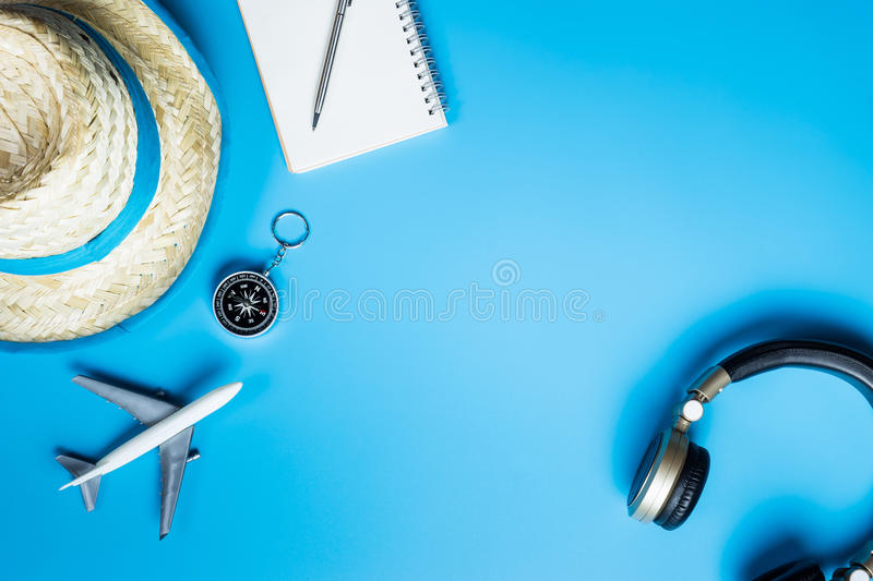 Summer travel object with headphone. On blue copy space stock image