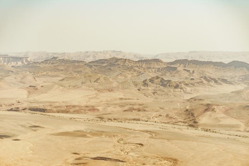Summer travel to israel negev desert full of sand. Landscape view on crater ramon. Middle east tourism stock image