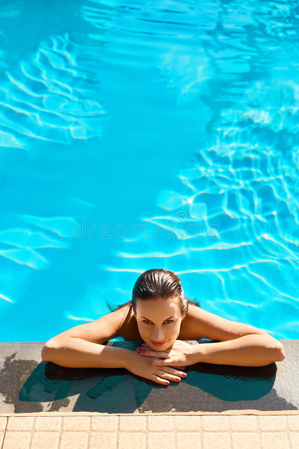 Summer Travel Vacation. Woman Relaxing In Pool. Healthy Lifestyle, Wellness. Summer Travel Vacation. Beautiful Young Woman Relaxing In Swimming Pool ( Water ) royalty free stock images