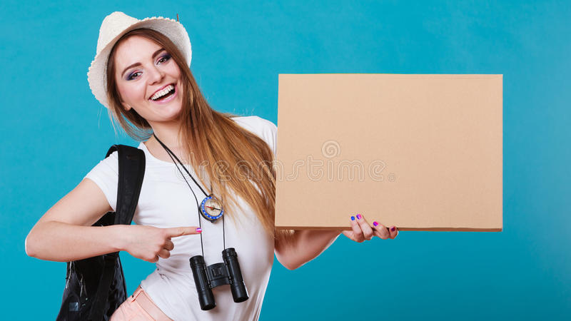 Summer traveler woman hitchhiking with blank sign. Summer tourism active lifestyle concept. Woman happy female tourist hitchhiking with blank sign cardboard on royalty free stock images