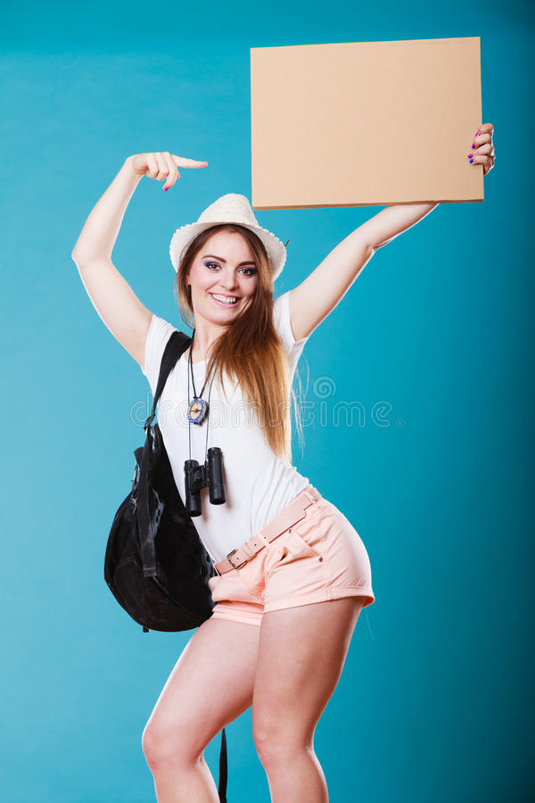 Summer traveler woman hitchhiking with blank sign. Summer tourism active lifestyle concept. Woman happy female tourist hitchhiking with blank sign cardboard on royalty free stock photo