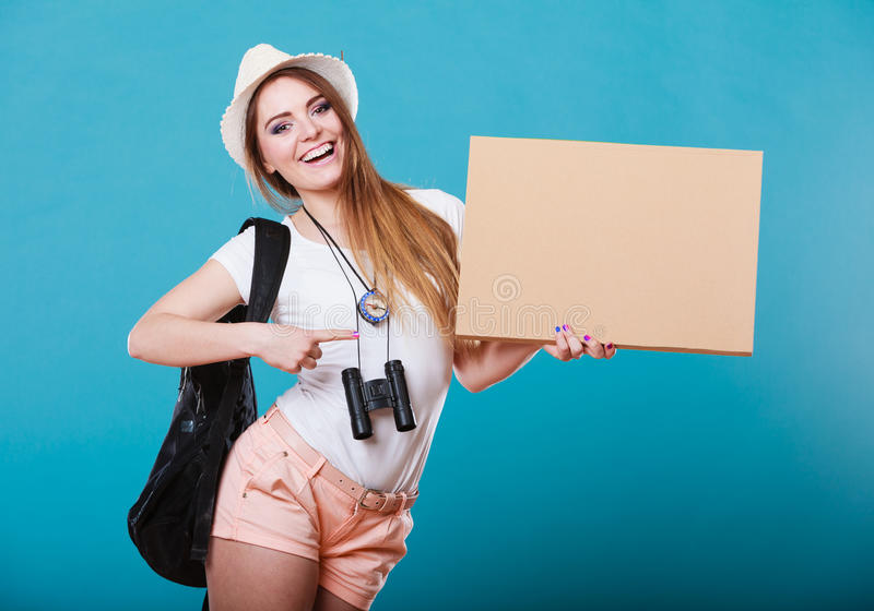 Summer traveler woman hitchhiking with blank sign. Summer tourism active lifestyle concept. Woman happy female tourist hitchhiking with blank sign cardboard on stock photography