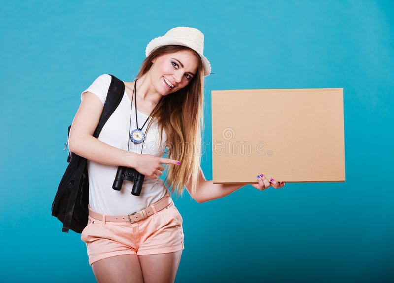 Summer traveler woman hitchhiking with blank sign. Summer tourism active lifestyle concept. Woman happy female tourist hitchhiking with blank sign cardboard on stock photo