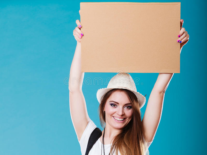 Summer traveler woman hitchhiking with blank sign. Summer tourism active lifestyle concept. Woman happy female tourist hitchhiking with blank sign cardboard on stock image