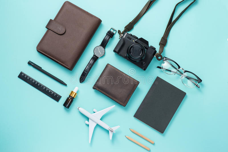 Summer traveling concept. Vacation accessories on blue background. stock images