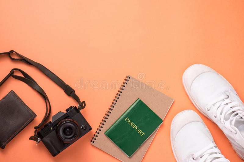 Summer traveling concept. Vacation accessories on orange background. royalty free stock photo