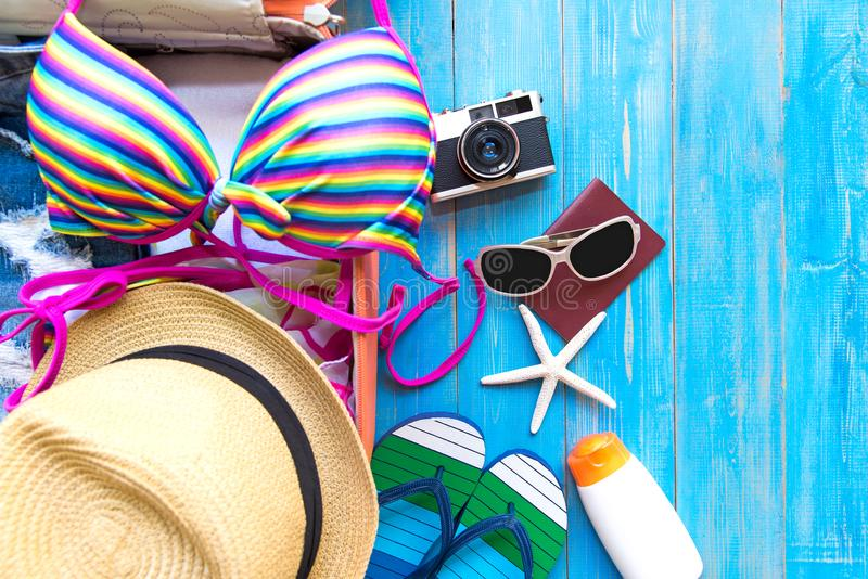 Summer traveling with old suitcase and Fashion woman swimsuit Bikini, fish star, sun glasses, hat. Travel in the holiday, sunset b. Each background. Summer and royalty free stock photos