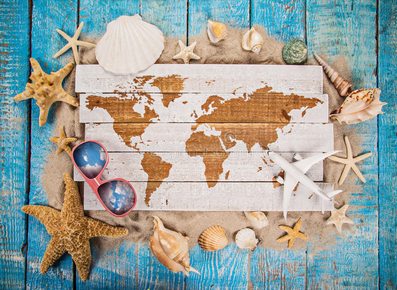 Summer traveling time. Sea holiday background with various shells. stock images