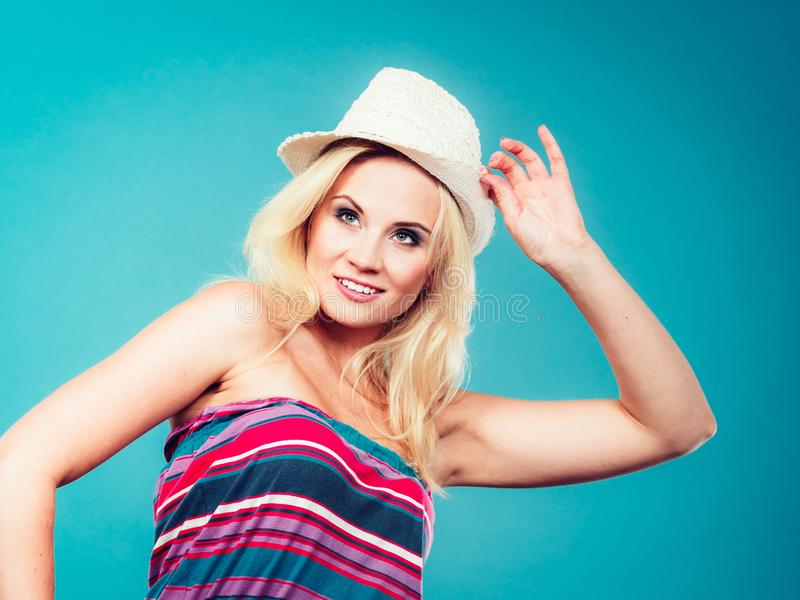 Blonde woman wearing colorful striped strapless shirt. Summer trendy fashionable outfit ideas concept. Blonde woman wearing colorful striped strapless shirt and royalty free stock photography