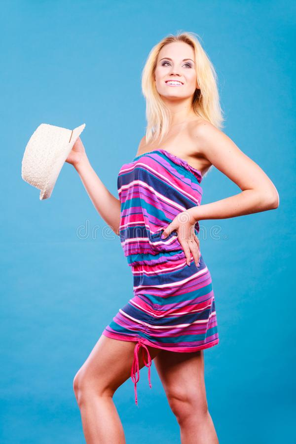 Blonde woman wearing short colorful striped dress stock photos