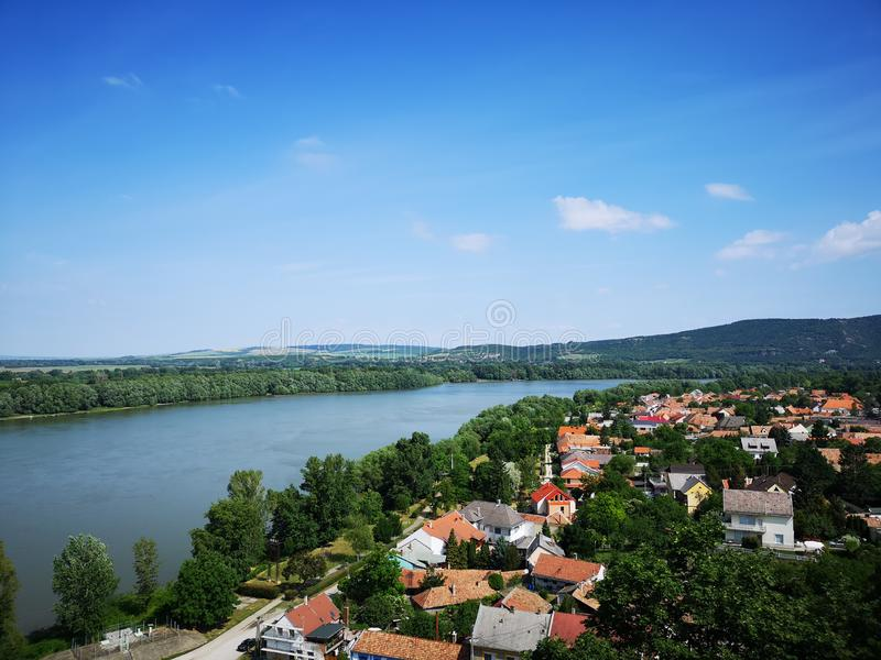 Landscape of Esztergom city with the Danube. A summer trip to Esztergom, landscape of the city and the Danube. The opposit side of the river is Párkány royalty free stock images