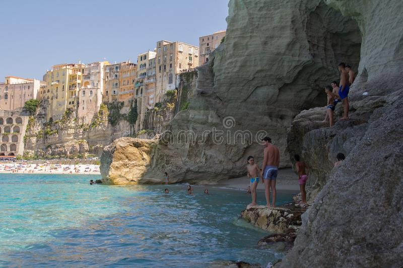 Tropea, Italy - June 2013: people swimming on the beach in popular summer destination, Tropea, Italy. stock image